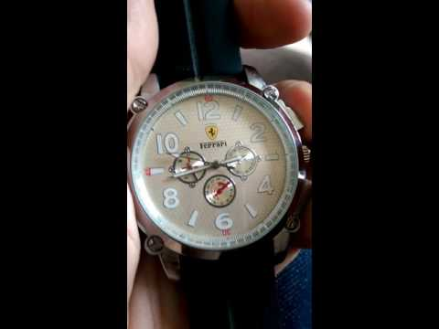 Ferrari self winding watch can anyone help tell me if it's real or fake and how much it's worth