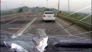 Debris crashing through windshield