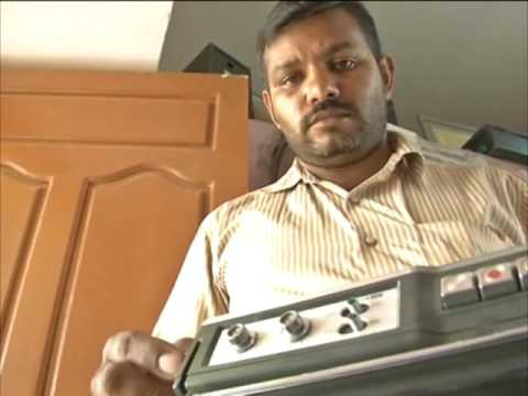 Auto rickshaw driver in southern India state running his own antique radio museum
