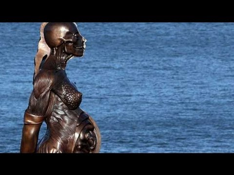 Damien Hirst's 'Verity' statue divides Devon town - YouTube