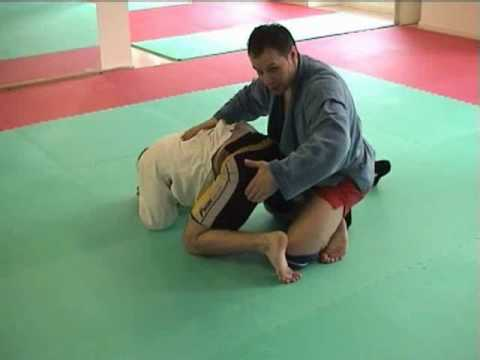Sambo Techniques - Attacking the Turtle: Rolling Achilles Lock Image 1