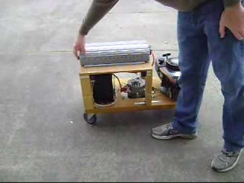 Lawn mower generator with 12 volt battery and inverter