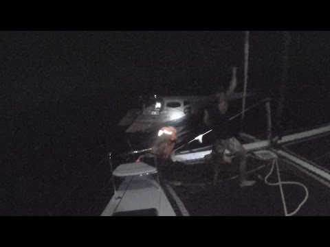 Sailing Yacht Rescue Crew off Sinking Boat at Night In the Caribbean Sea