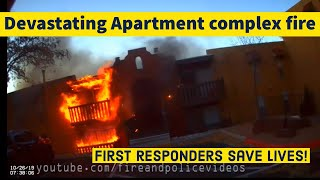 Heroic Firefighters and Police Officers Save Lives during a Raging Apartment Fire