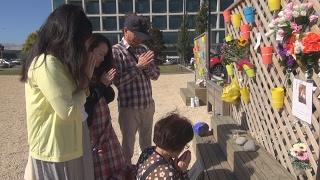 NZ地震の倒壊跡地に献花