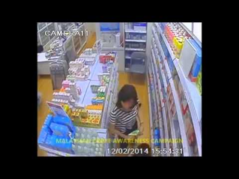 Malaysian Shoplifter with a child, caught in the Act