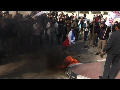Palestinian islamists burn French flag in a protest in Gaza City