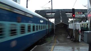 Parallel Action : Chugging  12633 Kanyakumari Express Vs Chennai EMU in Rain