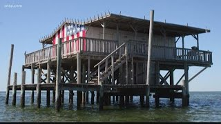 Family vows to rebuild its iconic American flag stilt house