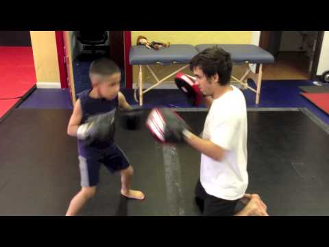 Future MMA star doing some focus mitt training! Image 1