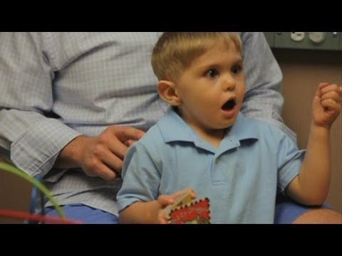 Amazing moment deaf three-year-old boy hears for the first time