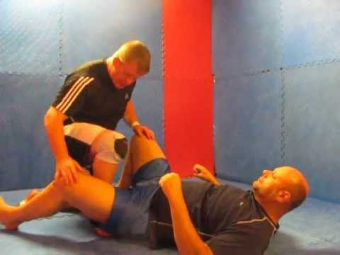 Rolling Leg Lock from De La Riva Guard (www.grappling-mechanics.com) Image 1