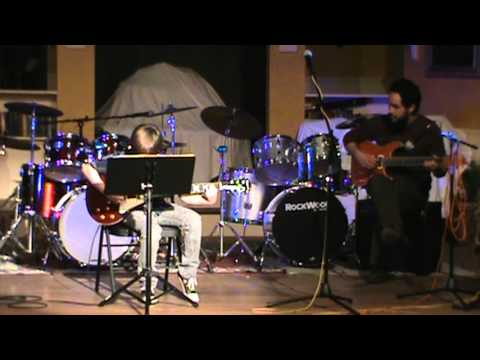 Asa Bebber Performs A Guitar Piece at the Hudson School of Music Winter Recital