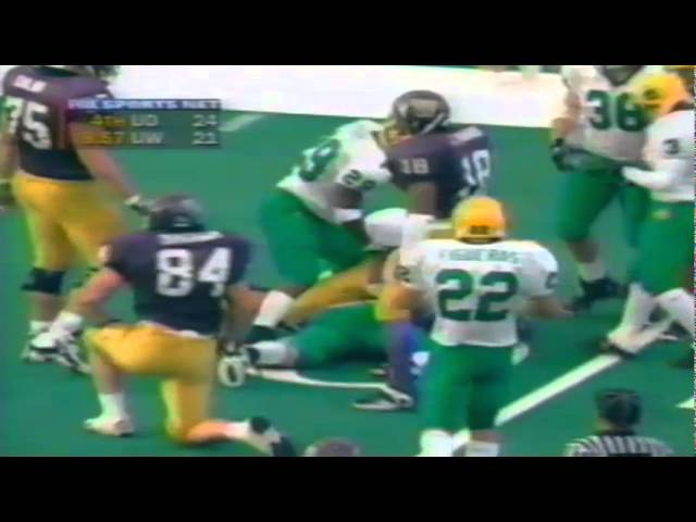 Oregon LB Garth White tackles UW QB Marques Tuiasosopo for a loss 11-08-97