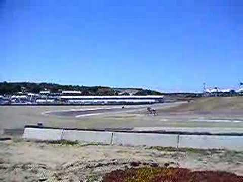 Shinya Nakano (Kawasaki ZX-RR, inline-4) and Makoto Tamada (Honda RC211V, vee-5) taking turn 10 at speed.