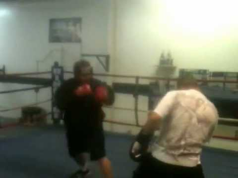 Boxing a pro for fun   At 255lbs (rd 2)