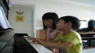 Ethel (7-yr-old) & Ethan (3-yr-old) practicing on duet