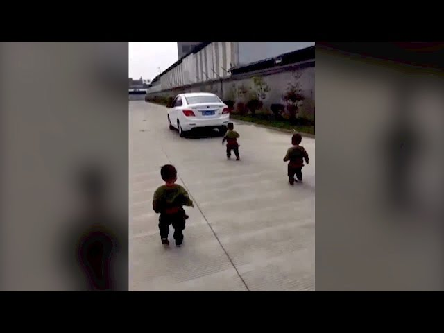 Watch: Triplets really don't want their dad to go to work