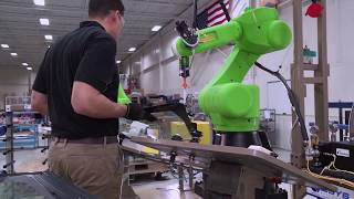 Collaborative Robot System for Applying Urethane to Automotive Glass – Esys Automation