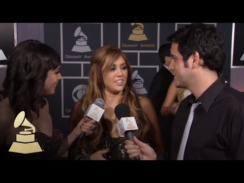 Miley Cyrus on the 53rd Annual GRAMMY Awards red carpet