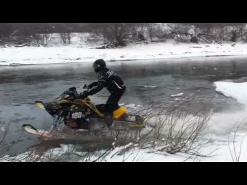 Mark Freeman 408 Sledding / Snowmobiling - open river / water