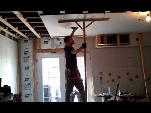 That is how it is done. Sheetrock to ceiling with two hands and a head.