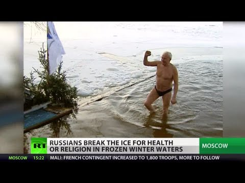 Plunge of Faith: Russians swim in freezing waters for health & religion