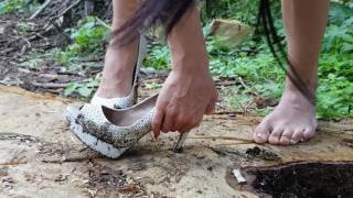 Expensive high heels in the woods wet and muddy