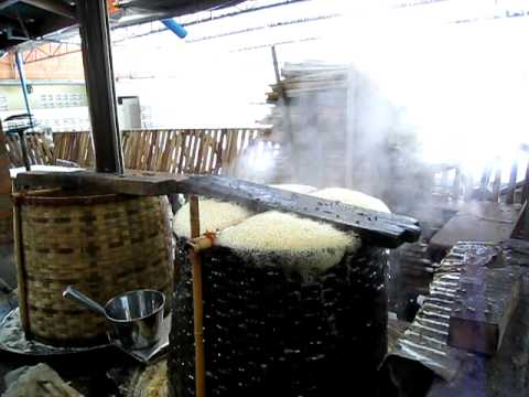 Making coconut sugar at the Floating Market, Bangkok