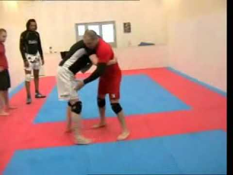 Sambo Techniques - Sambo Throws for Nogi #2 - Outside Trip Knee Block Image 1