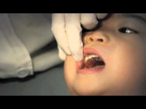 Houston Dentist- Kid receiving  first retainer while listening to Techno Music