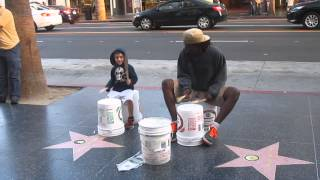 Street Performer Drums in Hollywood, CA, USA with Kids