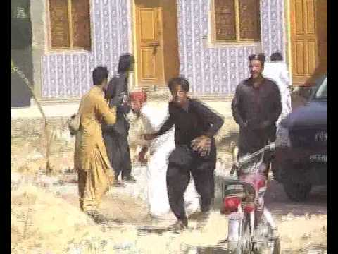 Jacobabad-Jakhrani Criminals Fighting With Police.flv
