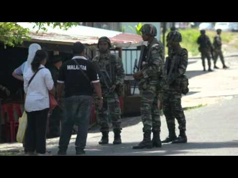 Gunmen kidnap Malaysian, Filipino off Sabah