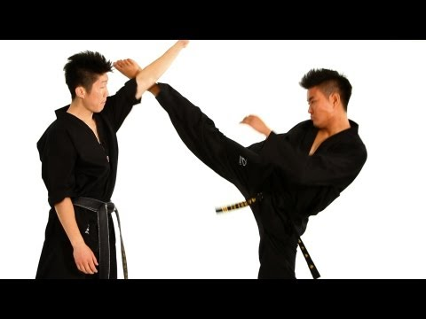 How to Do the Face Block Technique | Taekwondo Training Image 1