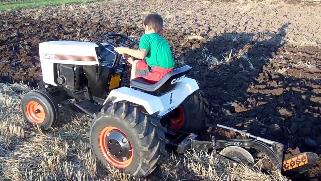 case   garden tractor plowing tire spinning