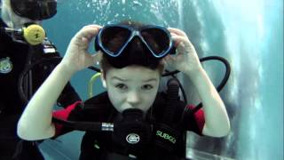 CHILD DIVER AND TEAM EXTREME DIVE