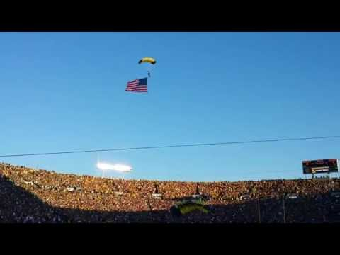 Navy Seals (Leap Frogs) parachute into Notre Dame Stadium