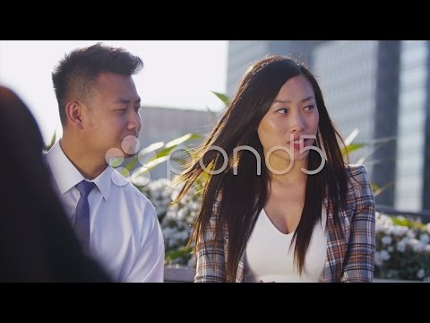 Young Asian Business Team In Open Air Meeting In The City Shake Hands On A Deal. Stock Footage