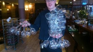 How to carry 24 wine glasses only one hand