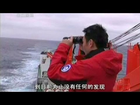 "Chinese plane sees suspicious ""white objects"" in search for missing Flight MH370"