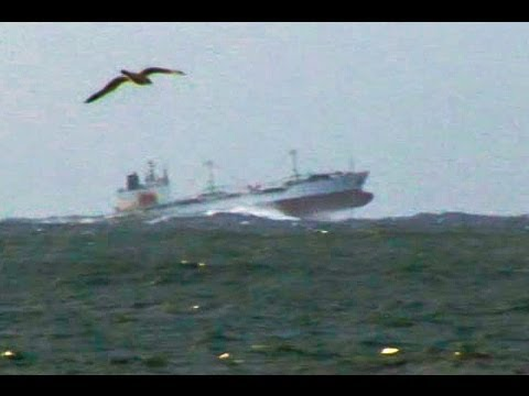 A ship bouncing at speed in rough seas off the east coast of South Africa. Filmed from the beach with a tripod. Zoomed in and sped up using Final Cut Pro. Tr...