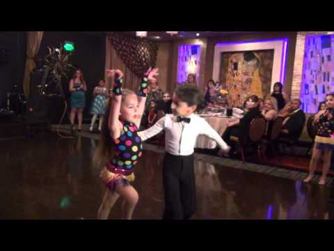 Kids dancing cha cha, rumba, jive, and samba