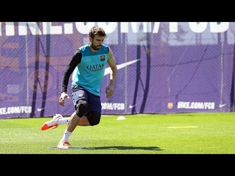 Training session 14/05/2014: Piqué and Jordi Alba do some work on the pitch