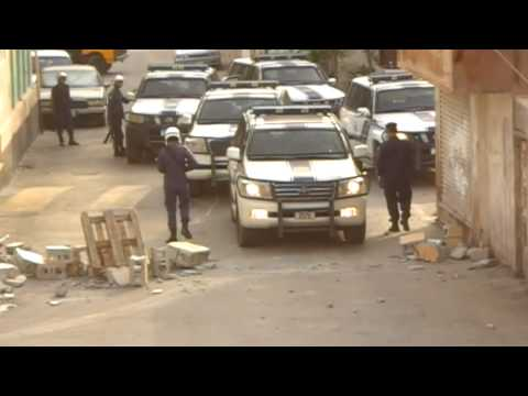 Bahrain: Riot police opening blocked roads by protesters @ Bani Jamra 22-6-2011 HQ