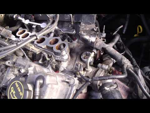 how to replace the camshaft position sensor on a 02 ford taurus
