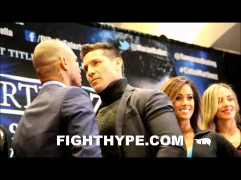 SERGIO MARTINEZ SIZES UP MIGUEL COTTO DURING FACEOFF IN NEW YORK