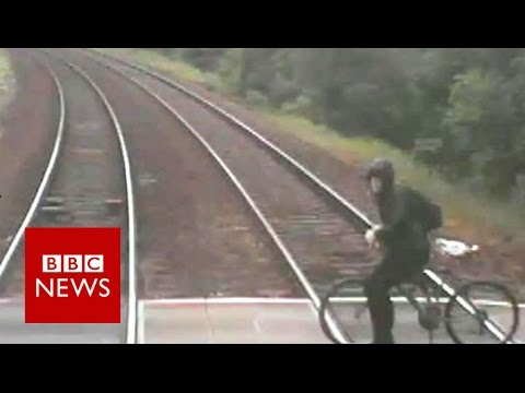 Cyclists near-miss with train released - BBC News