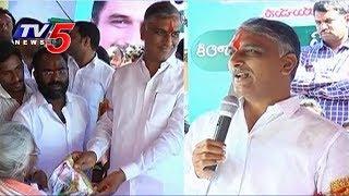 MInister Harish Rao Distributes Bathukamma Sarees In Siddipet