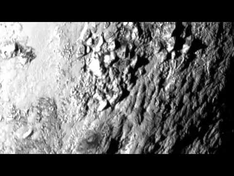 Wow! First Close Up Photo of Pluto Reveals Mountains and Water On Its Surface